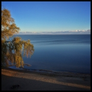 Bank of clouds on the far shore. Beautiful fall morning!